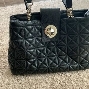 Kate spade black padded bag in black